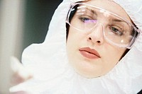 Close-up of a female researcher wearing protective gear