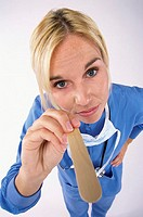 Portrait of a nurse holding a tongue depressor
