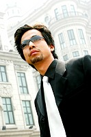 Man in business suit wearing sunglass.