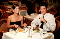 A couple having dinner in a restaurant.