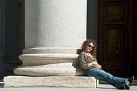Woman by column of Prado Museum, Madrid. Spain