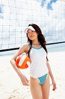 Young Woman by a Volleyball Net on the Beach
