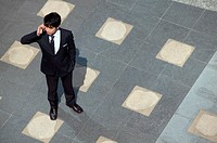 Elevated View of a Businessman Using a Mobile Phone