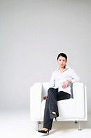 Businesswoman Sitting in an Armchair