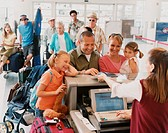 Family With Two Young Children Checks in at an Airport