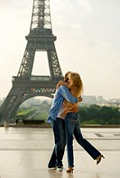France, Paris, couple embracing