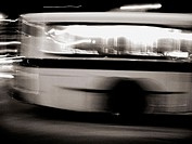 A New York City Bus is captured in a long time exposure, the final effect being a blured image with a lot of light trails. Very spooky and ghostly, ye...