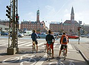 Cyclists waiting to cross Hans Christian Andersen Boulevard from Vesterbrogade. Radhuspladsen in front, Copenhagen, Denmark
