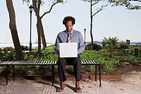 Man telecommuting in a park