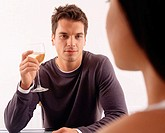 Man having wine with woman