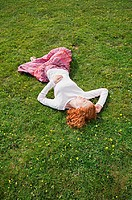 Woman sleeping in a field