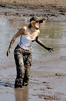 People with 4 wheelers and trucks on Sunday outing in the mud for fun and show of power and speed North FL