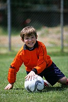 Young goalkeeper enjoying soccer