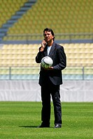 Soccer coach speaking on a mobile phone