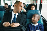 Man and Boy Riding Bus