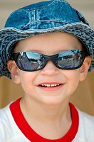 20 month old boy child baby with blue hat and sunglasses and some with mom