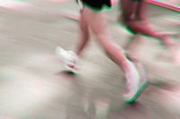Blurred running feet and legs of men racing