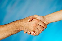 Close-up of a man and a woman shaking hands