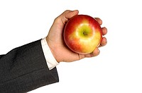 Close-up of a businessman holding an apple