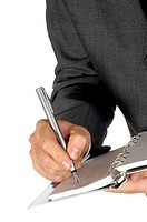 Close-up of a businessman writing on a spiral notepad