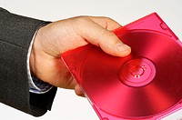 Close-up of a person's hand holding a compact disk