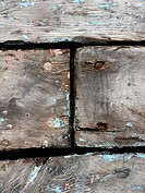 Close-up of joint in old wood planks with rusty nails