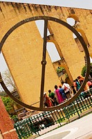 Rear view of tourists looking at a monument, Jantar Mantar, Jaipur, Rajasthan, India