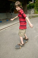13 year old Caucasian male on skateboard