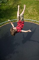 13 year old Caucasian male on trampoline