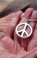 Peace symbol in hand of old person