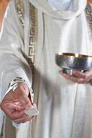 Priest´s Hand with Communion Wafer