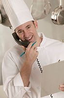 Chef talking on phone, portrait.