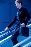 Blurred shot of woman descending stairs