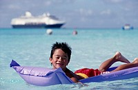 Boy on Inflatable Raft, Caribbean