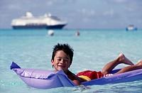 Boy on Inflatable Raft, Caribbean