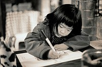 Girl Writing in Workbook