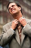 Businessman Loosening His Necktie