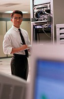 Businessman in Network Server Room