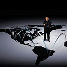 Businessman Standing on a Connected World