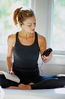 Woman in a Leotard Listening to a Portable Radio