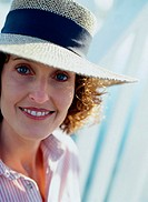 Portrait of a Smiling Woman in a Straw Hat