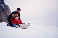 Family Sledding Together