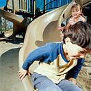 Young Boy and Girl on Playground Slide