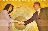 Business colleagues shaking hands smiling, digital composite