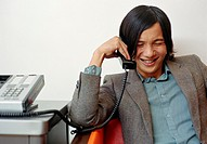 Young businessman on telephone, smiling