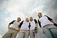 Teenage girls (13-15) in softball uniforms, portrait, low angle view