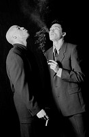 Two Men in Suits Smoking Cigars