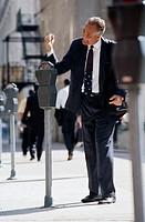 Aggravated Businessman Hitting Parking Meter