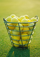 Basket of yellow golf balls (thumbnail)