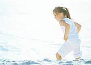 Girl wading in sea with clothes on